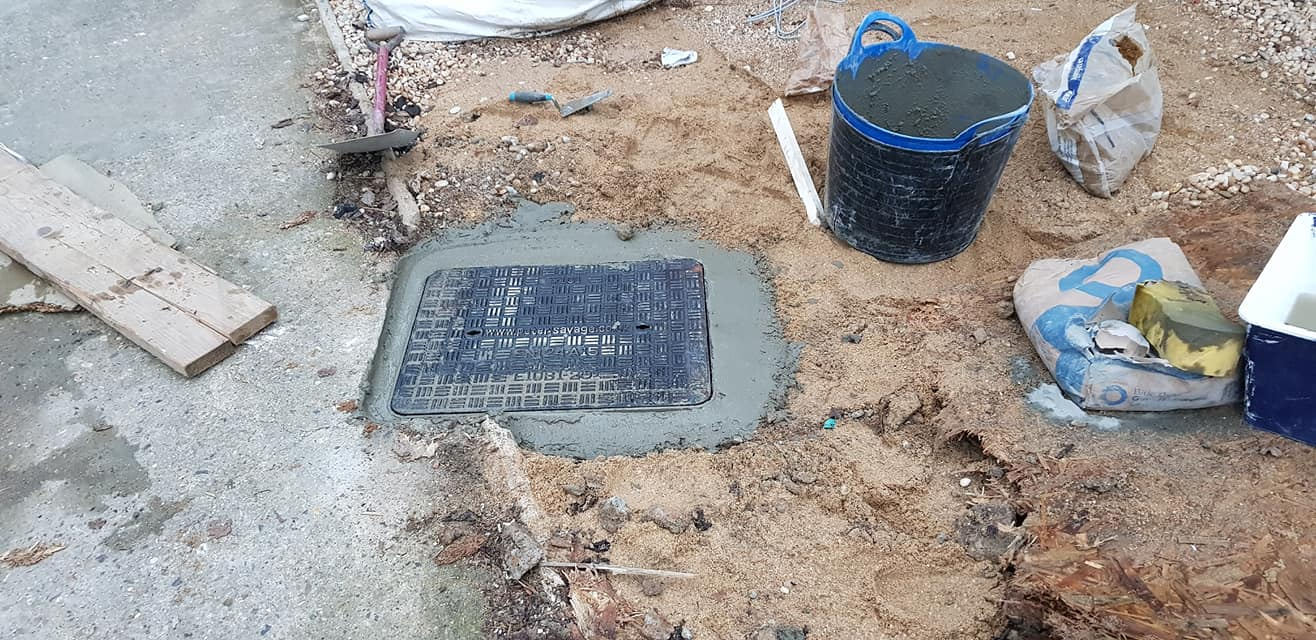 Drain repairs and manhole relocations